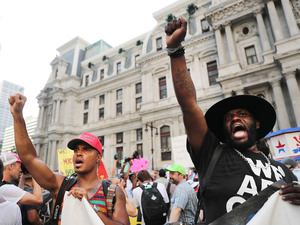 Protesters with the Black Lives Matter movement and other groups march through downtown Philadelphia during the Democratic National Convention.