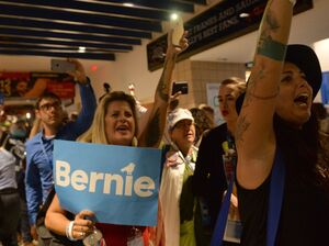 Bernie Sanders supporters walk out of the Democratic National Convention after Hillary Clinton became the official Democratic nominee on July 26 in Philadelphia.