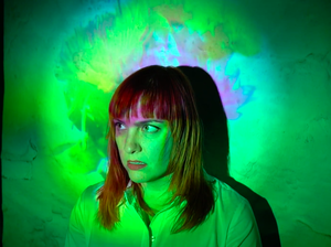 """Carly Commando of Slingshot Dakota in a scene from the video for """"Paycheck."""""""