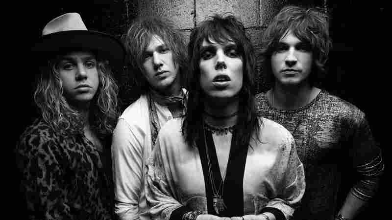 As The Struts, Luke Spiller (center) and his bandmates play glittery, '70s-style arena rock — and dress for the job.