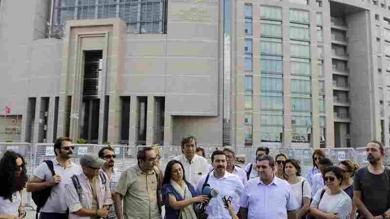 Journalists gather outside a court building to support journalist Bulent Mumay, who was detained Tuesday in connection with the investigation of the attempted coup in Turkey.