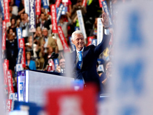 Former President Bill Clinton waves to the crowd as he arrives on stage to deliver remarks on the second day of the Democratic National Convention.