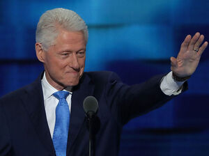 Former President Bill Clinton arrives on stage to deliver remarks on the second day of the Democratic National Convention, July 26, at the Wells Fargo Center in Philadelphia.
