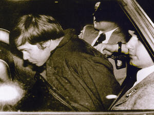 John Hinckley Jr. is escorted by police in Washington, D.C., following his arrest after shooting and seriously wounding president Ronald Reagan on March 30, 1981.