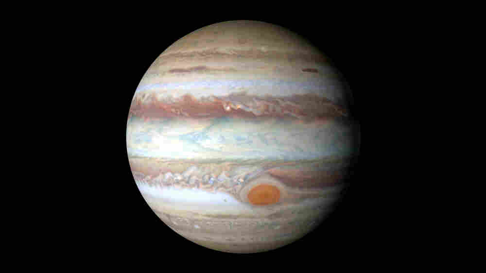 How Jupiter's Red Spot Makes Things High Above It Hot, Hot, Hot