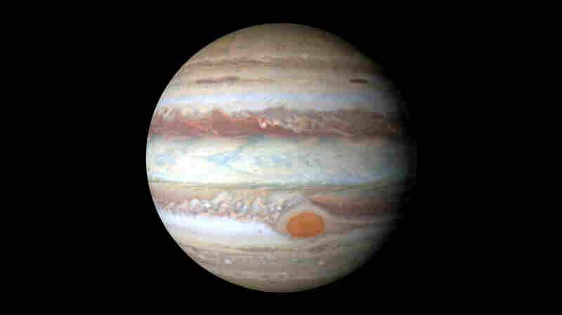 Though Jupiter's red spot looks small in this photo, it's actually about 10,000 miles wide — bigger than Earth's diameter.