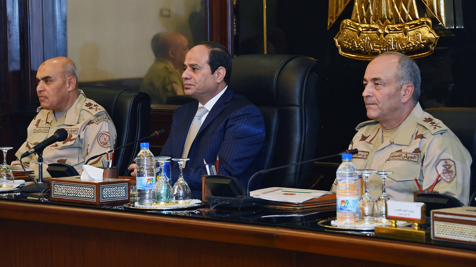 Egypt's President Abdel-Fatah el-Sissi (center) chairs a meeting of the Supreme Council of the Armed Forces in Cairo last November. As head of the military, Sissi was behind the coup that toppled Egypt's elected government in 2013. (AP)