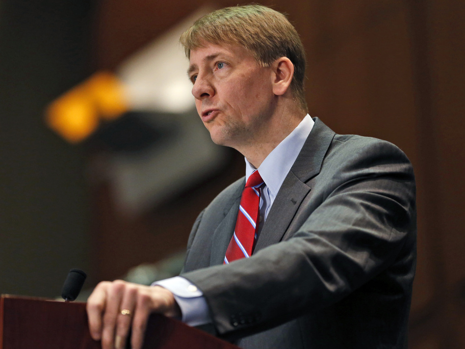 Richard Cordray, shown here at a March 2015 hearing, directs the Consumer Financial Protection Bureau, which has proposed new rules to overhaul the multi-billion dollar debt collection industry.) (Steve Helber/AP)