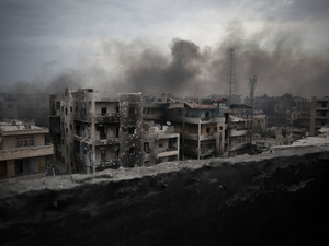 Smoke rises over Saif Al Dawla district in Aleppo, Syria, in 2012. Russia and the Syrian government say they will open humanitarian corridors in Aleppo and offer a way out for opposition fighters wanting to lay down their arms, Russian Defense Minister Sergei Shoigu said Thursday.