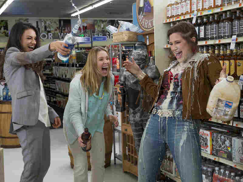Mila Kunis, Kristen Bell and Kathryn Hahn demonstrate one of the messiest ways to make a white Russian in Bad Moms.