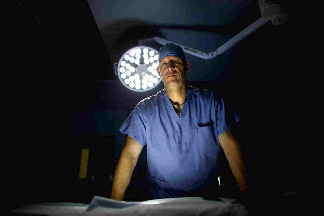 U.S. Air Force Lt. Col. Chance Henderson, an orthopedic surgeon, stands in the operating theater of the military hospital at Bagram Airfield in Afghanistan. Henderson has saved the leg of a 6-year-old Afghan girl who was shot during a firefight between U.S. and Afghan forces and the Taliban.