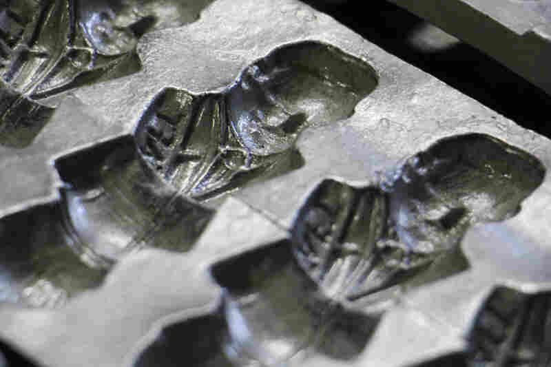 An antique mold holds the image of President Taft.