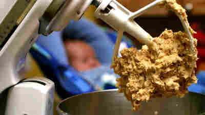 Cookie dough clings to the beaters of a standing mixer. The Food and Drug Administration is warning people not to eat raw dough due to an ongoing outbreak of illnesses linked to flour tainted with E. coli.