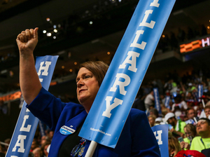 "Supporters on the floor of the Democratic National Convention hold ""Hillary"" signs on the night the candidate accepts the nomination."