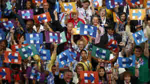 Delegates from New York hold signs in support of Hillary Clinton, the 2016 Democratic presidential nominee, during the Democratic National Convention (DNC) in Philadelphia, Pennsylvania, U.S. on Tuesday.