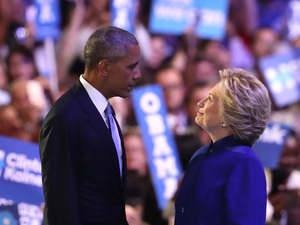 President Obama and Hillary Clinton stand together on stage on the third day of the Democratic National Convention in Philadelphia.
