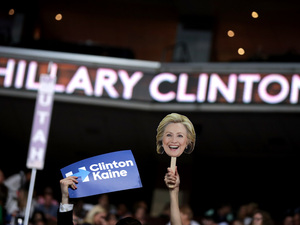 Attendees hold up signage in support of Democratic presidential nominee Hillary Clinton and  vice presidential nominee Tim Kaine on the fourth day of the Democratic National Convention at the Wells Fargo Center in Philadelphia.