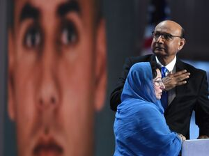 Khizr Khan, father of Humayun S. M. Khan, who was killed while serving in Iraq with the U.S. Army, gestures as his wife looks on during the final evening of the Democratic National Convention.