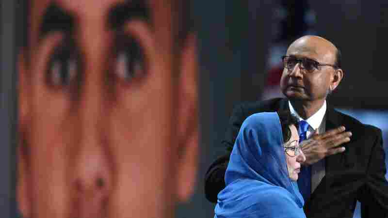 Khizr Khan, father of Humayun Khan, who was killed while serving in Iraq with the U.S. Army, gestures as his wife looks on during the final evening of the Democratic National Convention.