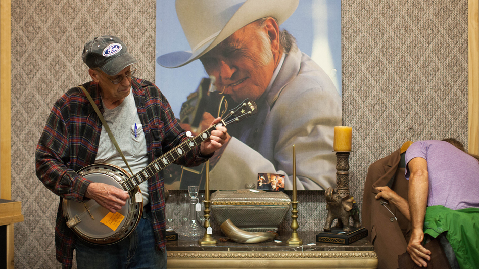Prospective customers browse the effects at Bill Monroe's estate sale. (WPLN)