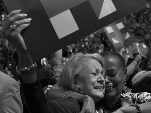 Johnnie Roebuck (left) and Joyce Elliott, from the Arkansas delegation, celebrate as Clinton is named the Democratic presidential nominee.