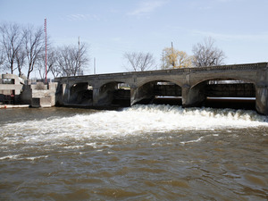 The Flint River in downtown Flint, Mich. The state's attorney general, Bill Schuette, announced felony and misdemeanor charges Friday against six state employees in connection with the lead-contamination of the city's drinking water