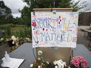 "A sign reading ""Your Life Mattered"" hangs on a podium outside J.J. Hill Montessori School in St. Paul, Minn., on July 14, following a funeral service for Philando Castile at the Cathedral of St. Paul. Castile, who worked at Montessori as a cafeteria manager, was shot and killed by police on July, 6."