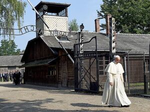 Pope Francis walks through the entrance to the site Auschwitz concentration camp in what was Nazi-occupied Poland.