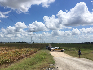 Police cars block access to the site where a hot air balloon crashed early Saturday in central Texas.