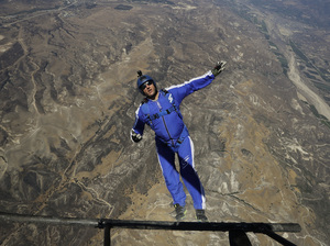 Luke Aikins jumps from a helicopter during his training on Monday, in Simi Valley, Calif. After months of training, the skydiver ditched his chute to free fall 25,000 feet above Simi Valley, on Saturday.