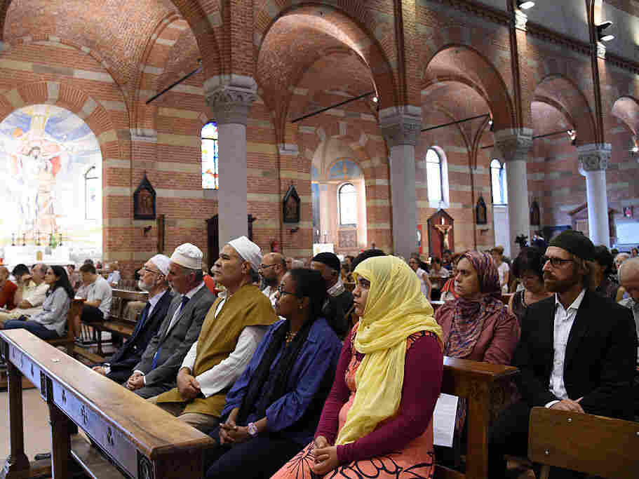 Members of the Muslim community attend a mass in the Catholic church of Santa Maria of Caravaggio on Sunday in Milan, Italy.