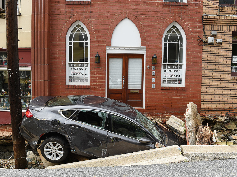 Flooding along Main Street in Ellicott City upended cars, destroyed buildings and killed at least two people. Here, a car sits crushed under the rubble of a sidewalk downtown.