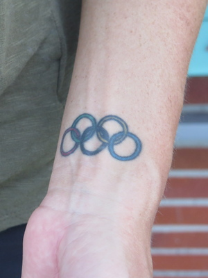 Anderson has the Olympic rings tattooed on her left wrist.