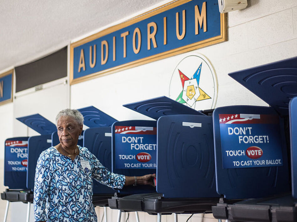 A poll worker prepares a voting machine before the South Carolina primary. The recent hacking of the Democratic Party databases has raised questions about potential issues with voting systems. (Sean Rayford/Getty Images)