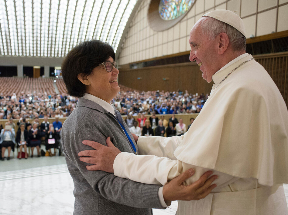 Pope Francis hugs Sister Carmen Sammut at the end of a meeting in May with hundreds of women who serve the Roman Catholic Church. The pontiff has appointed a commission to study whether women can serve as deacons. (AP)