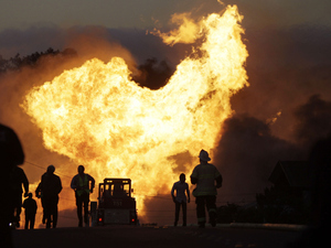 A massive gas pipeline fire roared through a neighborhood in San Bruno, Calif., on Sept. 9, 2010. Federal prosecutors, without explanation, slashed the potential criminal penalties they were seeking in the trial of utility giant PG&E for violating gas pipeline safety laws.