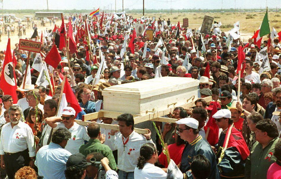 More than 40,000 people attended Chavez's funeral on April 29, 1993. The casket was carried through Arizona farmland. (Mike Nelson/AFP/Getty Images)