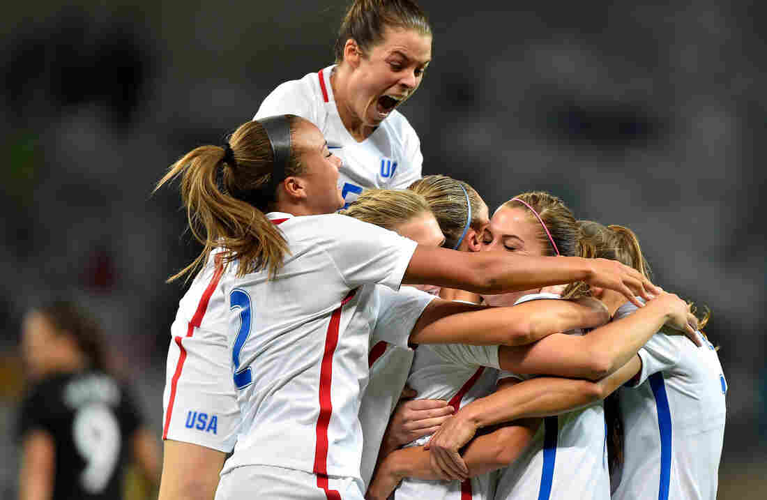 Kelley O'Hara (top) joins her American teammates in celebrating a second-half goal by Alex Morgan in the U.S. women's soccer team's Group G first-round win over New Zealand in Belo Horizonte, Brazil, Wednesday.