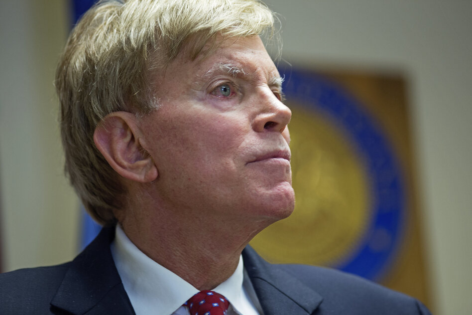 "Former Ku Klux Klan leader David Duke talks to the media at the Louisiana secretary of state's office in Baton Rouge, La., on July 22, after registering to run for the U.S. Senate. ""The climate of this country has moved in my direction,"" Duke said as he announced his candidacy, one day after Donald Trump accepted the GOP nomination for president. (Max Becherer/AP)"