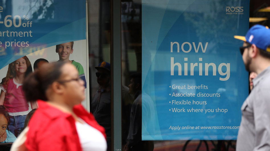 """A """"'now hiring"""" sign is posted outside of a Ross Dress for Less store on July 8 in San Francisco. (Justin Sullivan/Getty Images)"""