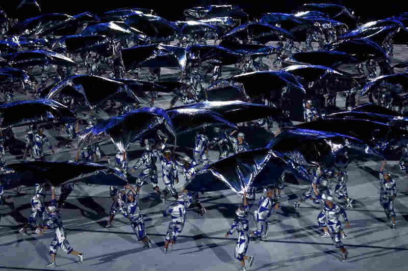 Performers dance during the Olympics Opening Ceremony on Friday.
