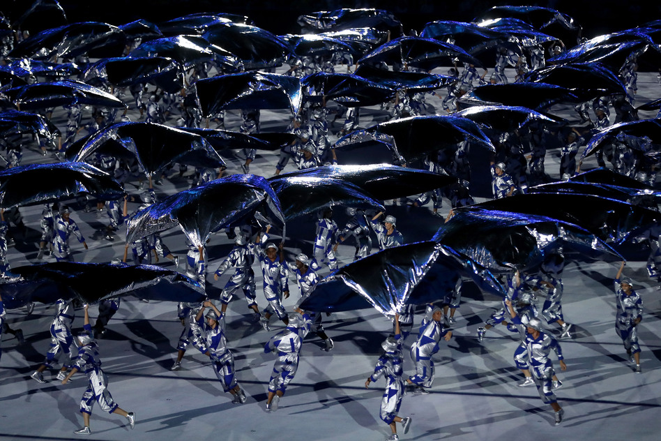 Performers dance during the Olympics Opening Ceremony on Friday. (Getty Images)