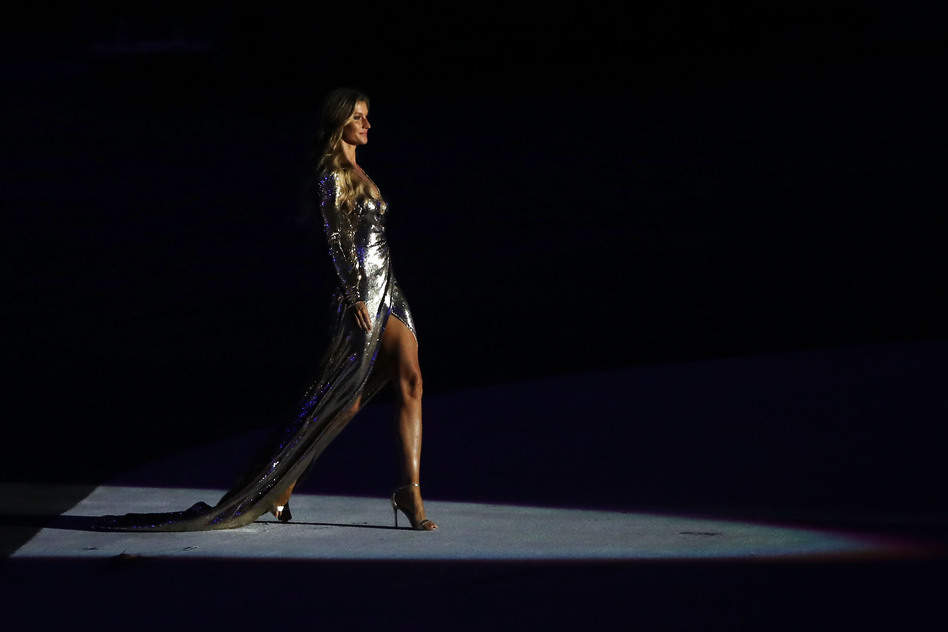 Supermodel Gisele Bundchen walks as The Girl From Ipanema during the Bossa segment during the Opening Ceremony. (Getty Images)