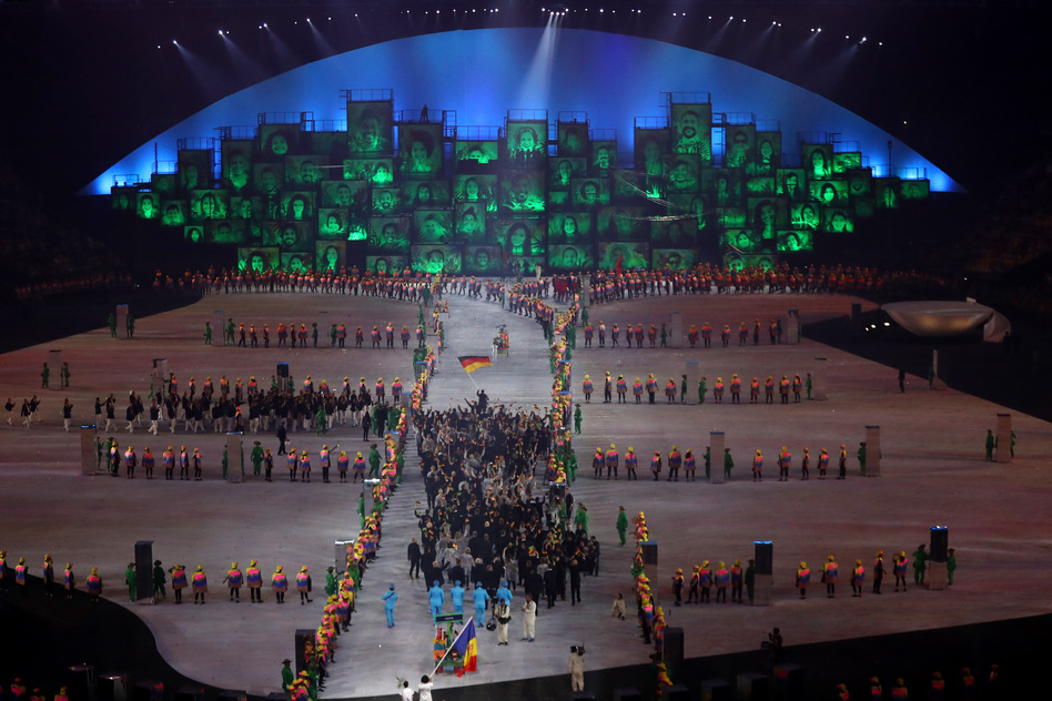 Athletes walk into the stadium during the Parade of Nations. (Getty Images)