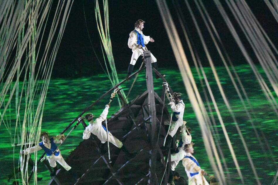 Acrobats simulate the arrival of Europeans in ships, three mechanical Caravels, where they meet indigenous people.  (Getty Images)