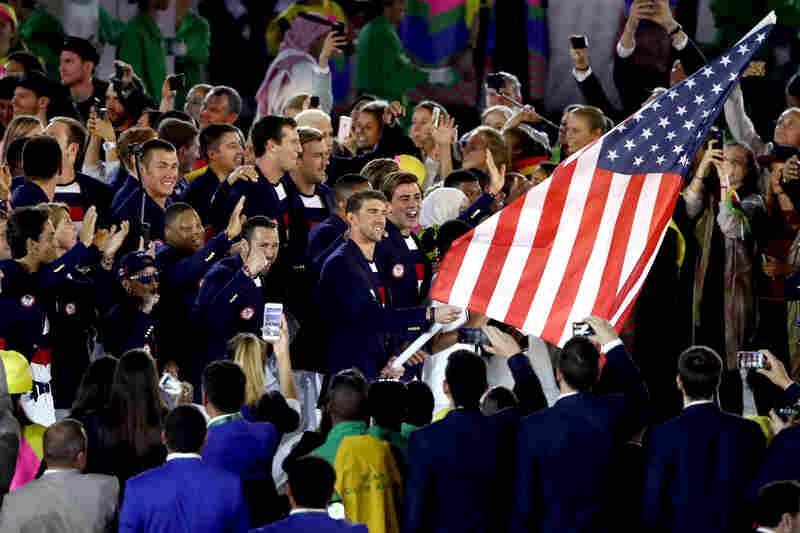 Flag bearer Michael Phelps and Ibtihaj Muhammad lead the U.S. Olympic Team during the Opening Ceremony.
