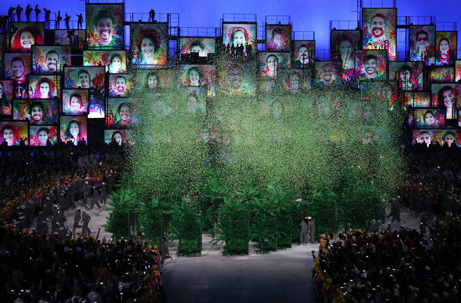 A tiny forest of green trees explodes upward into confetti.  (Getty Images)