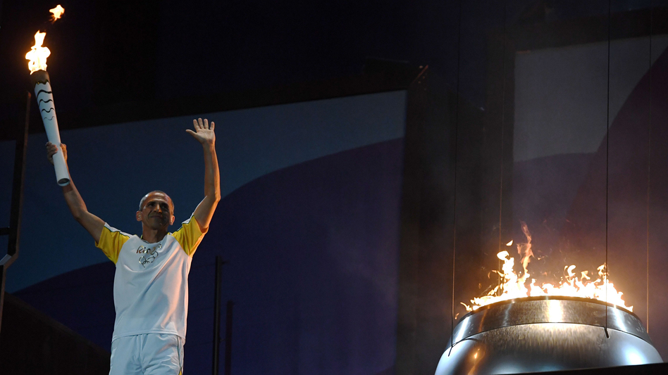 Vanderlei Cordeiro de Lima, beloved marathon runner who won a bronze medal at the 2004 Summer Olympics in Athens, lights the Olympic cauldron. (AFP/Getty Images)