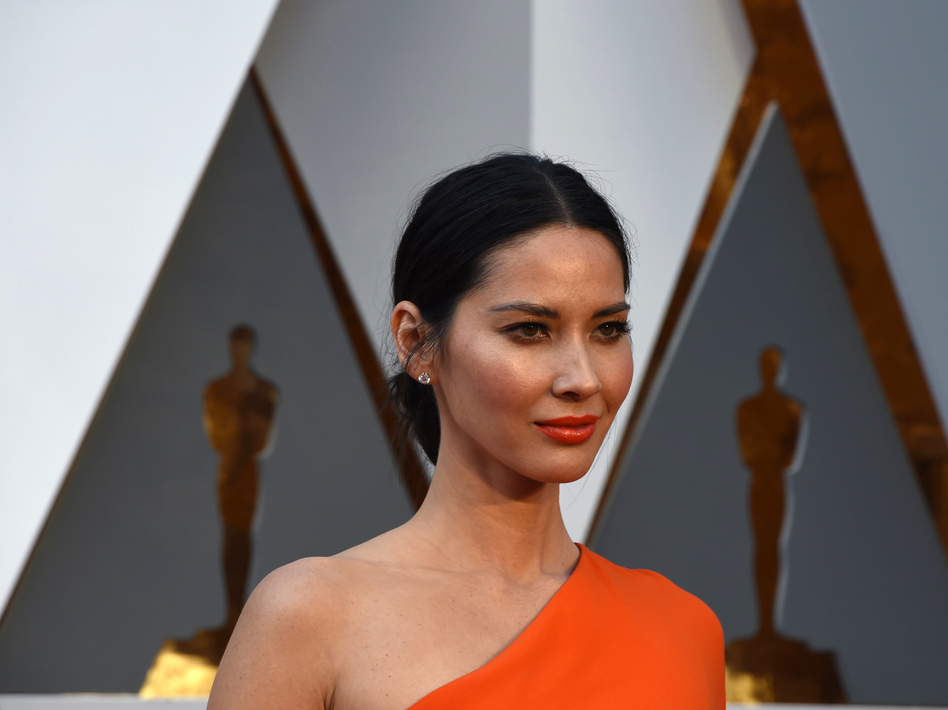 Actress Olivia Munn arrives on the red carpet for the Oscars on Feb. 28. Munn has spoken about being connected to multiple parts of East Asia. (AFP/Getty Images)