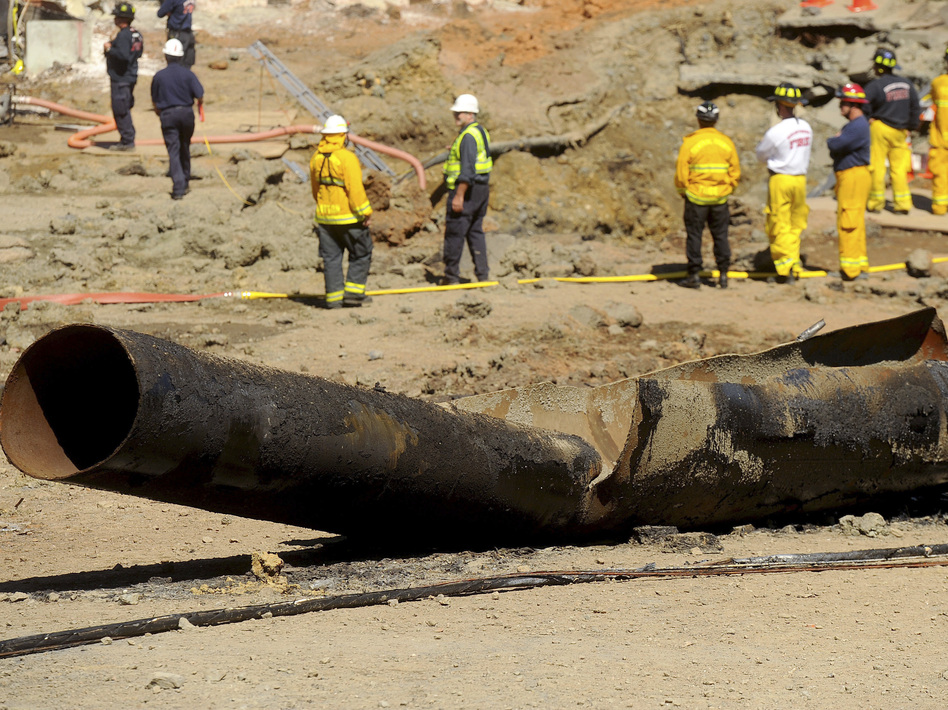 A natural gas line lies broken in San Bruno, Calif., after a massive explosion on September 9, 2010. A federal jury found Pacific Gas & Electric Co., California's largest utility, guilty of misleading investigators about how it was identifying high-risk pipelines. (Noah Berger/AP)